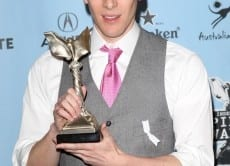 86740 dustin lance black poses with his award for best first screenplay for milk at the 24th annual film i